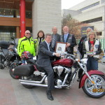 Ottawa Mayor Jim Watson has a seat on Big Red at Motorcycle Safety Awareness Month launch 2012